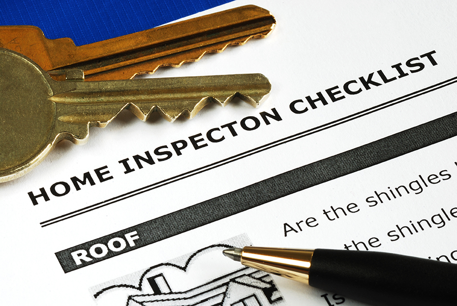 Top corner of a Home Inspection Checklist with house keys and a pen.